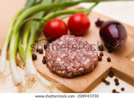 raw meatball on a chopping board and ingredients. horizontal. close-up  - stock photo