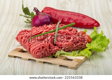 Raw minced beef with onion - ready for cooking - stock photo