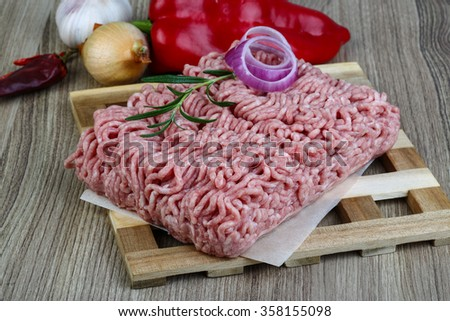 Raw minced pork meat with onion and rosemary ready for cooking - stock photo