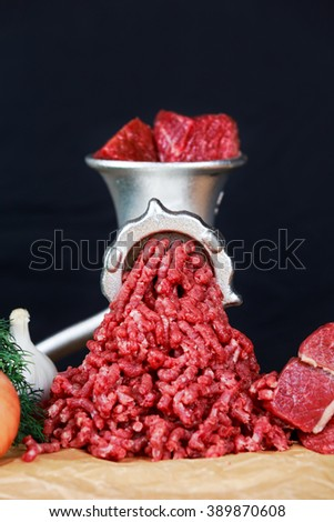 Raw Mincer with fresh minced beef meat - stock photo