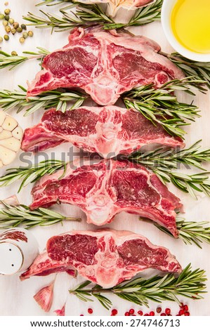 Raw  mutton meat, lamb loin chops with fresh herbs and oil, top view, close up