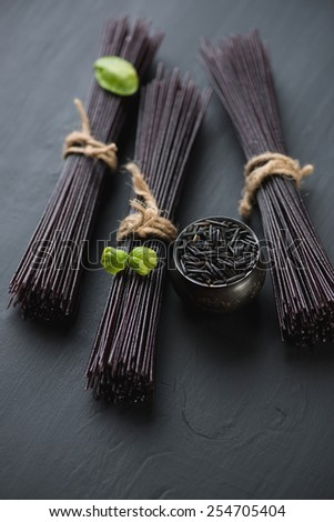 Raw noodles made of black rice, studio shot, selective focus - stock photo