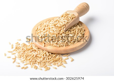 raw oats on the white background