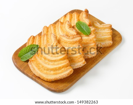 Raw of puff pastry cookie with powder sugar