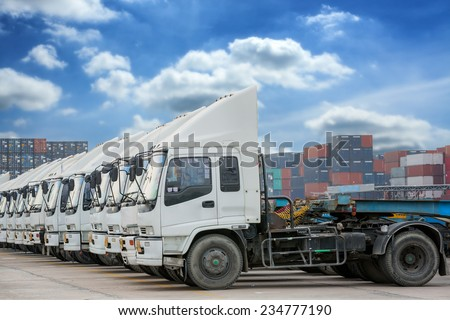 Raw of Truck in container depot with blue sky and logistic background - stock photo