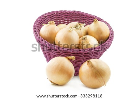 Raw onions in a basket, isolated on white - stock photo