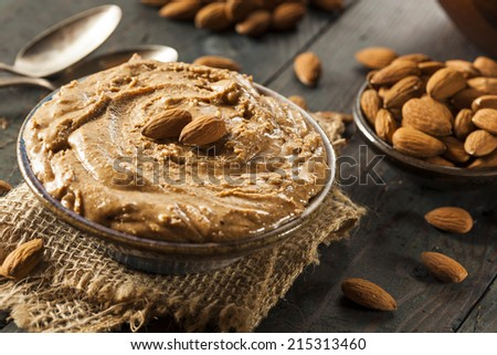 Raw Organic Almond Butter on a Background - stock photo