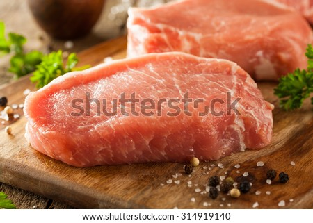 Raw Organic Boneless Pork Chops Ready to Cook - stock photo