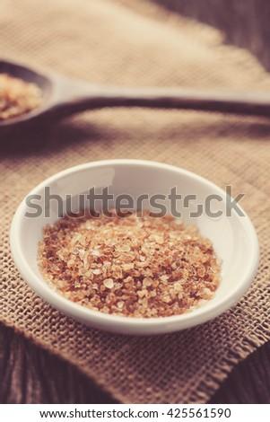 Raw Organic Cane Sugar in white ceramic bowl - stock photo