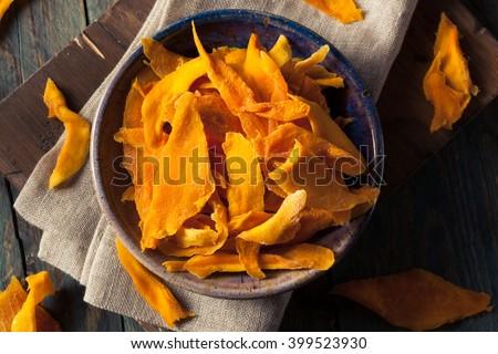 Raw Organic Dried Mangos in a Bowl - stock photo