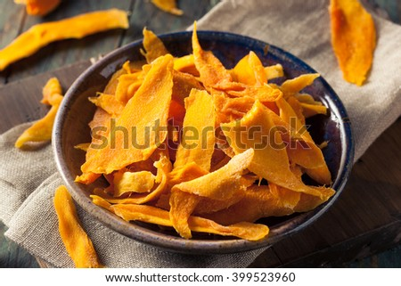 Raw Organic Dried Mangos in a Bowl - stock photo