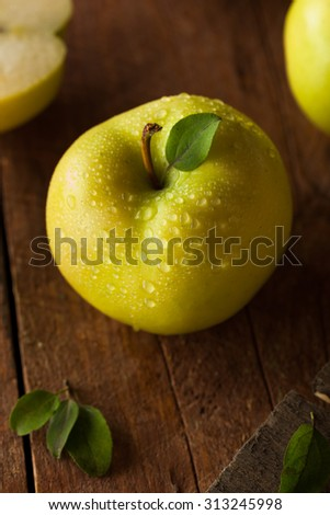 Raw Organic Golden Delicious Apples Ready to Eat - stock photo