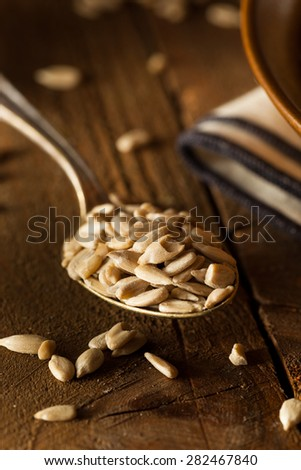 Raw Organic Hulled Sunflower Seeds in a Bowl - stock photo