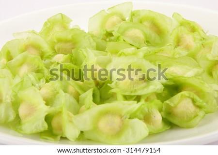 Raw Organic moringa seeds . - stock photo