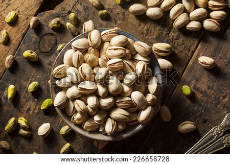 Raw Organic Pistachio Nuts in a Bowl - stock photo