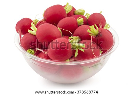 Raw organic small garden radishes in a bowl on white background - stock photo