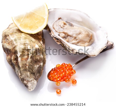 Raw oyster,lemon and red caviar isolated on a whte background.