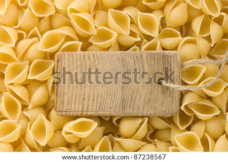 raw pasta and price tag as background - stock photo