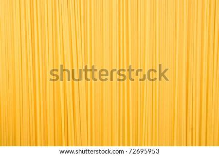 raw pasta as whole background - stock photo