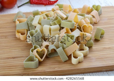 Raw pasta hearts symbols ready for cooking