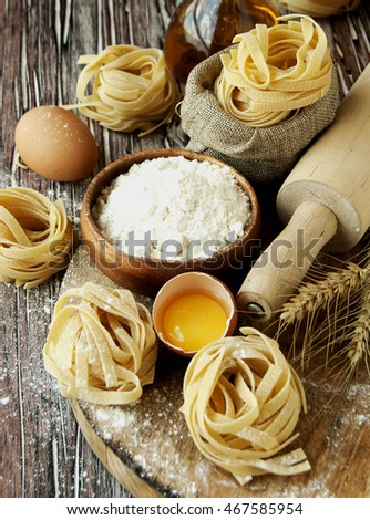 raw pasta with ingredients for cooking, selective focus