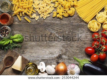 Raw Pasta with ingredients on wooden background - stock photo