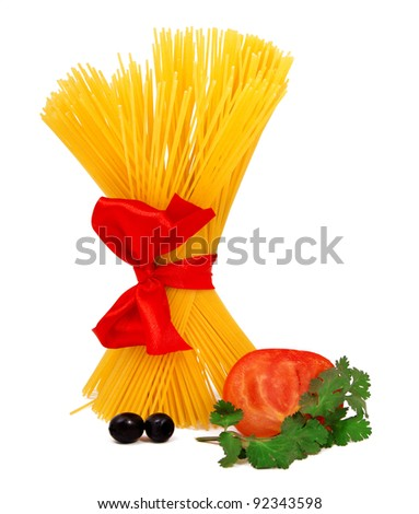 Raw pasta with red ribbon and tomato isolated on white - stock photo