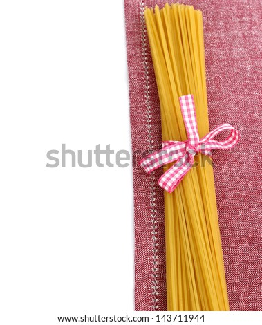 raw pasta with ribbon on napkin - stock photo