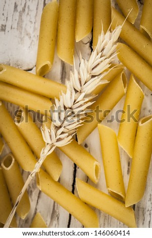 Raw pasta with wheat ears