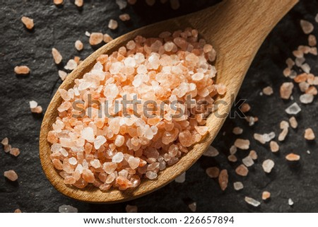 Raw Pink Himalayan Sea Salt in a Spoon - stock photo