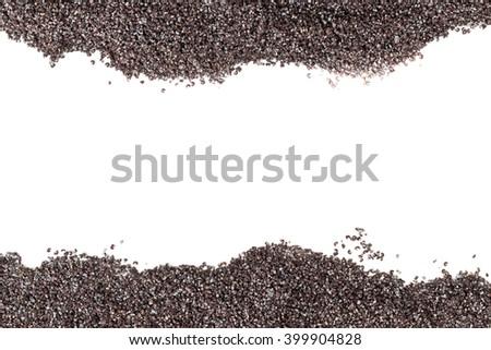 Raw poppy seeds border over white background - stock photo