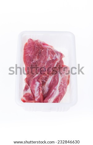 raw pork in plastic box package isolated on white background - stock photo