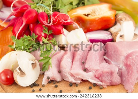 Raw pork meat and the fresh vegetables - stock photo