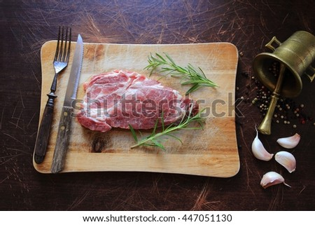 Raw pork meat with ingredients. View from above - stock photo