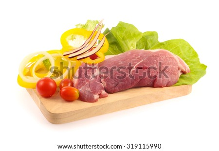 raw pork meat  with vegetable on chopping block isolated on white background  - stock photo