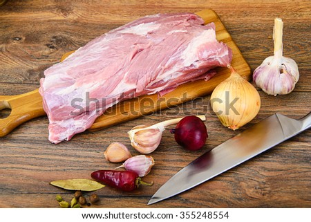 Raw Pork on a Cutting Board Studio Photo