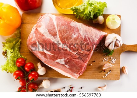 Raw pork on cutting board