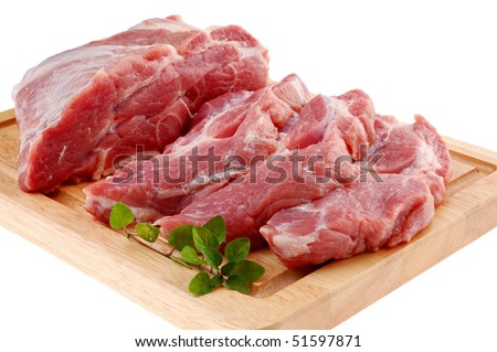 Raw pork on cutting board isolated on white background - stock photo