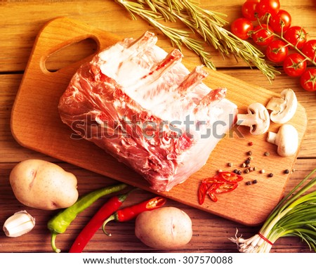 Raw pork on the wooden board.Filtered image: warm cross processed vintage effect. - stock photo