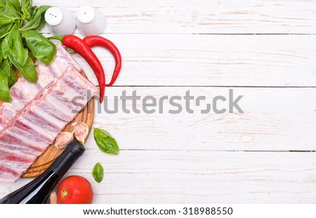 Raw pork rib meat on wooden board. Background.