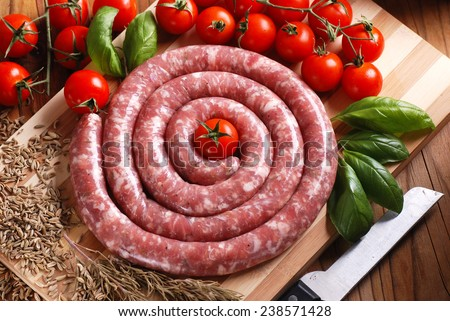 raw pork sausage with fennel seeds - stock photo