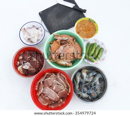 Raw pork, shrimp,squid,crab,meat on table for cooking  - stock photo