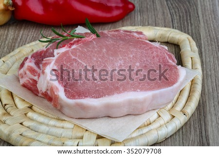 Raw pork steak with rosemary ready for cooking - stock photo