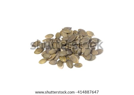 Raw pumpkin seeds, isolated on white background
