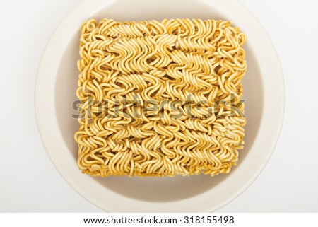 raw quick noodle on white dish - stock photo