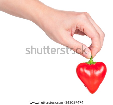 Raw red pepper in the form of heart in the hand isolated over white background - stock photo