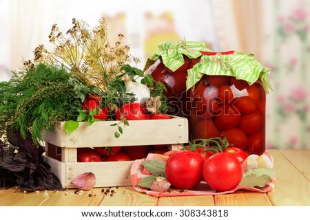 Raw red Tomatoes and herbs in crate