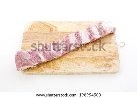 raw rib on chopping block ready to cooking - stock photo