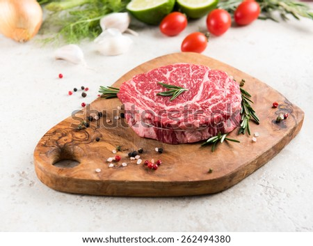 Raw Ribeye Steak with Herbs and Spices - stock photo