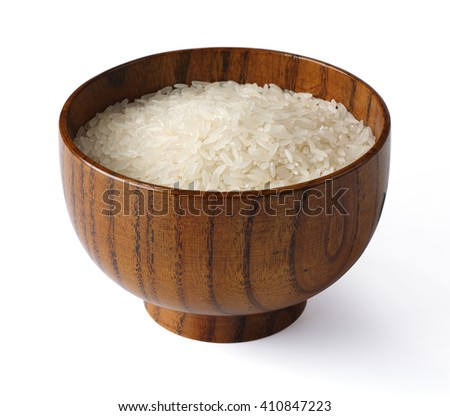 Raw rice in a wooden bowl